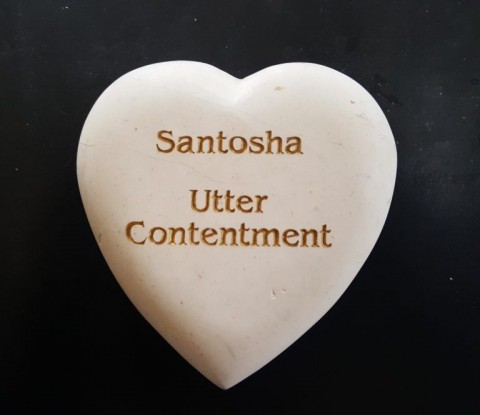 santosha, which is Sanskrit for contentment.