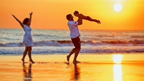 happy-family-walking-with-fun-on-sunset-sea-beach-picture-id665585456