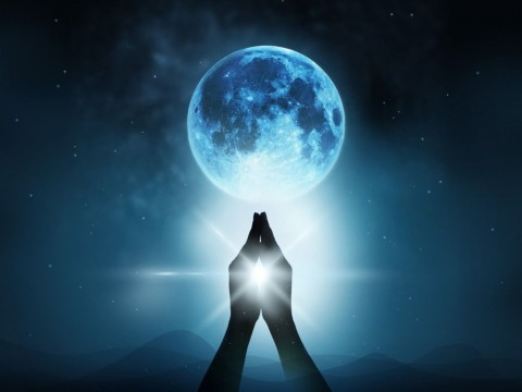 respect-and-pray-on-blue-full-moon-with-nature-background-picture-id502257084