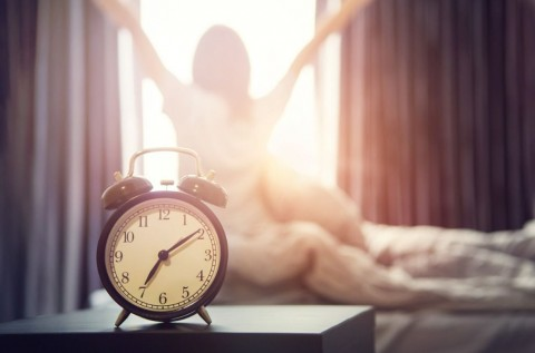 alarm-clock-having-a-good-day-in-morning-picture-id624545084
