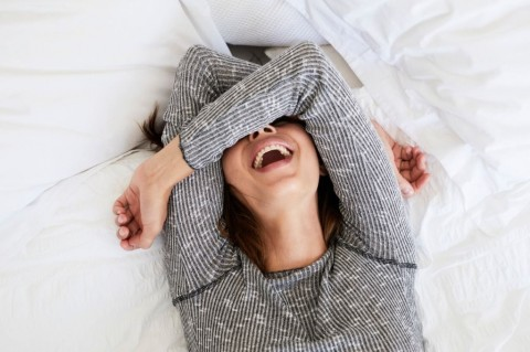 laughing-babe-in-bed-picture-id664635052
