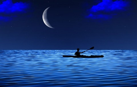 young-man-floating-on-the-canoe-in-the-sea-at-starry-night-with-moon-picture-id832548916