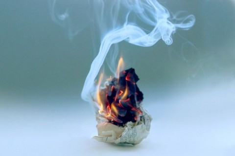 crumpled-paper-burning-in-fire-picture-id904146554