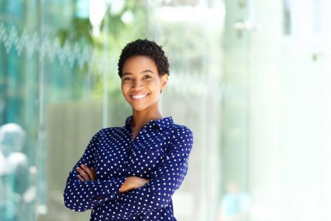 smiling-african-business-woman-outside-in-city-picture-id868866570