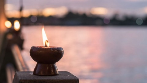 spirituality-and-tranquility-abstract-concept-with-candle-light-and-picture-id975574928