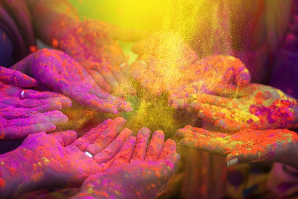 hands-and-colorful-powders-of-the-holi-festival-picture-id505746242