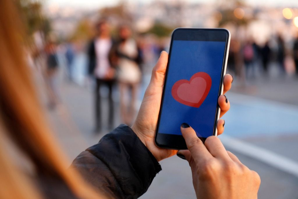 hand-holding-smart-phone-with-sending-heart-picture-id867746454