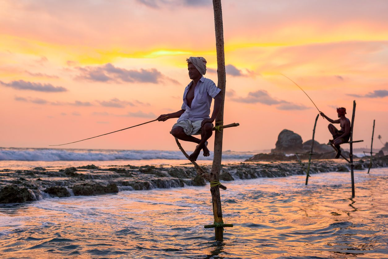 Traditional fishermen at the evening near Galle in Sri Lanka.