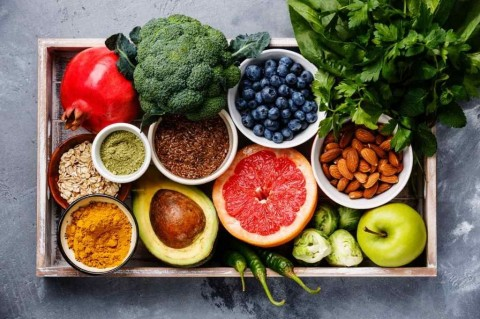 healthy-food-clean-eating-selection-in-wooden-box-picture-id918035290