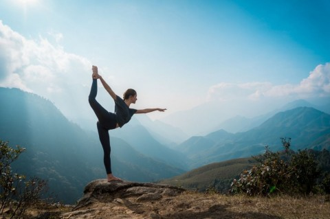 woman-training-yoga-mountains-on-background-picture-id936401520