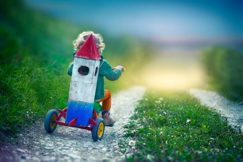 child-with-toy-space-rocket-and-tricycle-picture-id913705186