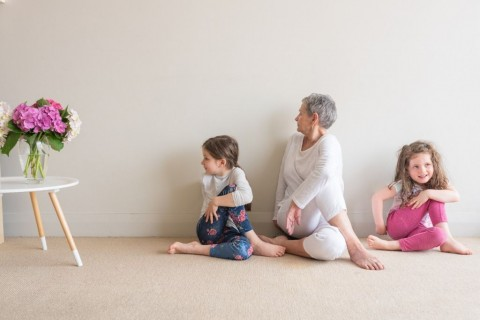 older-woman-and-young-children-doing-yoga-picture-id1076818380