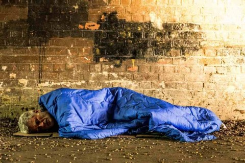 homeless-senior-male-sleeping-rough-in-subway-tunnel-picture-id954097972