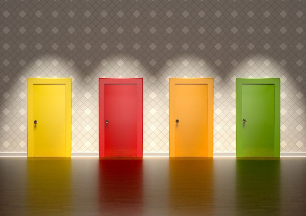 colored-doors-in-a-room-representing-the-concept-of-choice-picture-id1059714144