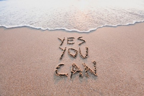 yes-you-can-motivational-inspirational-message-on-sand-picture-id1003163388