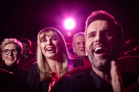 people-watching-comedy-movie-in-theater-picture-id1159203817