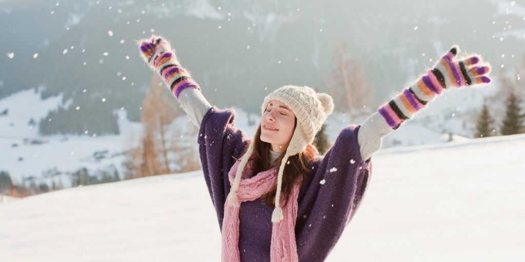 woman-with-arms-outstretched-in-snow-picture-id102284321