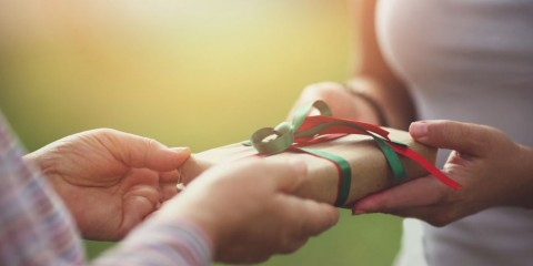 hands-giving-gift-closeup-picture-id1074536676