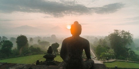 scenic-view-of-borobudur-temple-at-sunrise-in-fog-picture-id1158438860