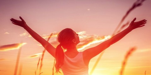 free-and-happy-woman-raises-arms-against-the-sunset-sky-harmony-and-picture-id1131849259
