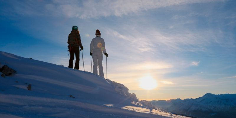 friends-skiing-snow-skiers-skiing-at-sunny-ski-resort-sunset-in-picture-id1089636072