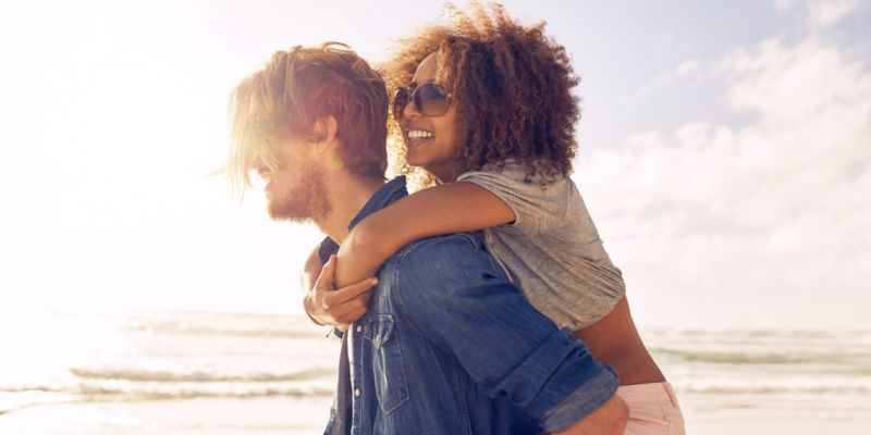 young-couple-enjoying-their-summer-vacation-on-beach-picture-id526715532