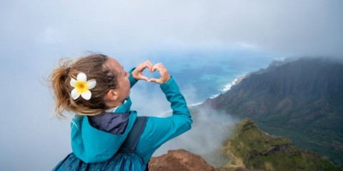 woman-making-heart-frame-on-spectacular-landscape-in-hawaii-from-top-picture-id1192417995