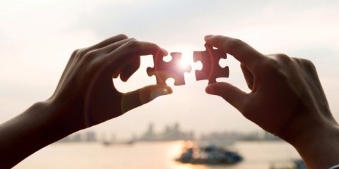 puzzle-pieces-and-human-hands-picture-id543673052