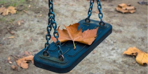 empty-swing-at-the-park-picture-id1213877125