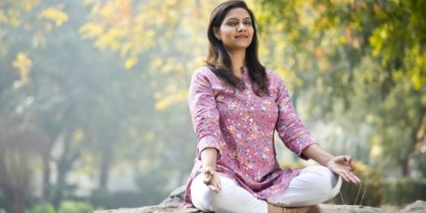 beautiful-woman-meditating-position-at-park-picture-id1205339396