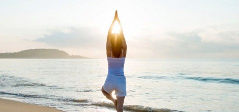 woman-doing-yoga-at-the-beach-picture-id1177568976-1