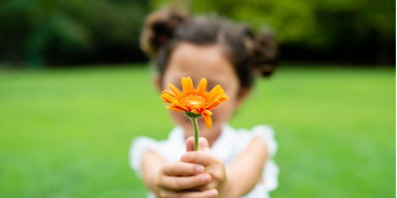 girl-with-flower-picture-id1014834536