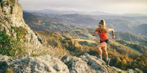 young-woman-running-on-mountain