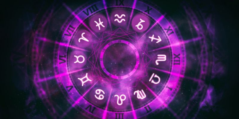 purple-astrological-wheel-with-zodiac-symbols-and-night-starry-sky-picture-id1220988541