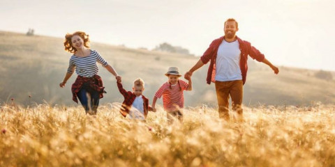 happy-family-mother-father-children-son-and-daughter-runing-and-on-picture-id1205460641