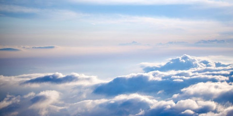 aerial-view-of-a-cloudscape-on-a-clear-day-picture-id186872841