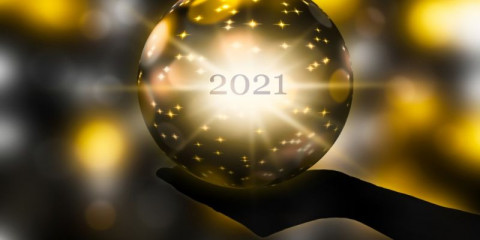 crystal-ball-in-a-hand-prediction-for-new-year-2021-on-abstract-shiny-picture-id1279175030