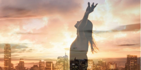 woman-in-the-city-with-arms-up-to-the-sunset-sky-feeling-happy-picture-id1249879129