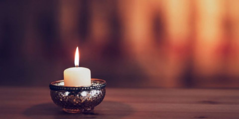burning-candle-on-the-table-picture-id1301777039
