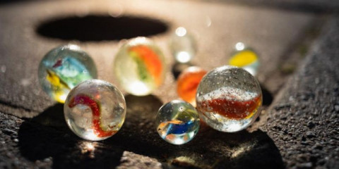 group-of-marbles-on-the-sidewalk